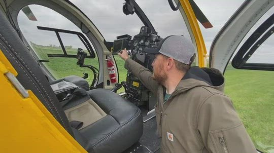 Crop dusting helicopter shows at fly-in